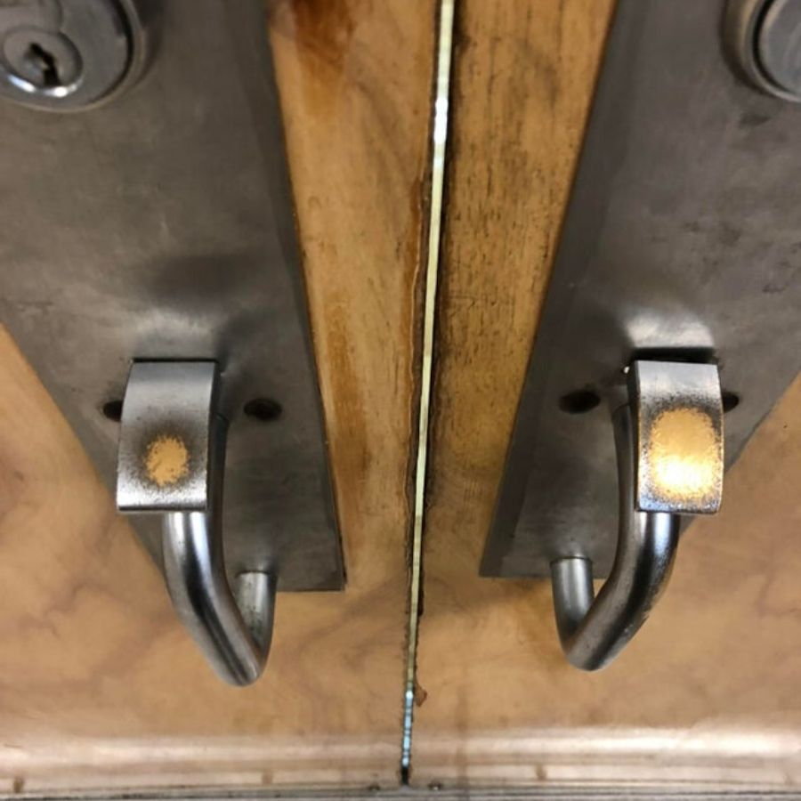 left and right handle on door where right handle has more wear and tear