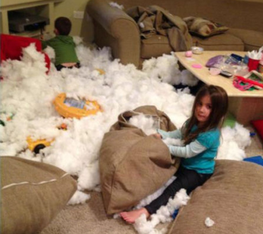 A kid pulling out the stuffing from pillows