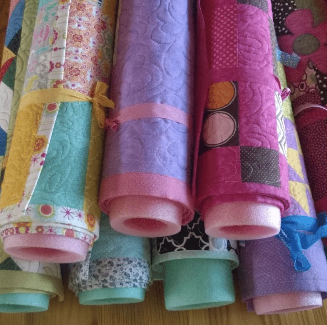 pool noodles used for quilt storage