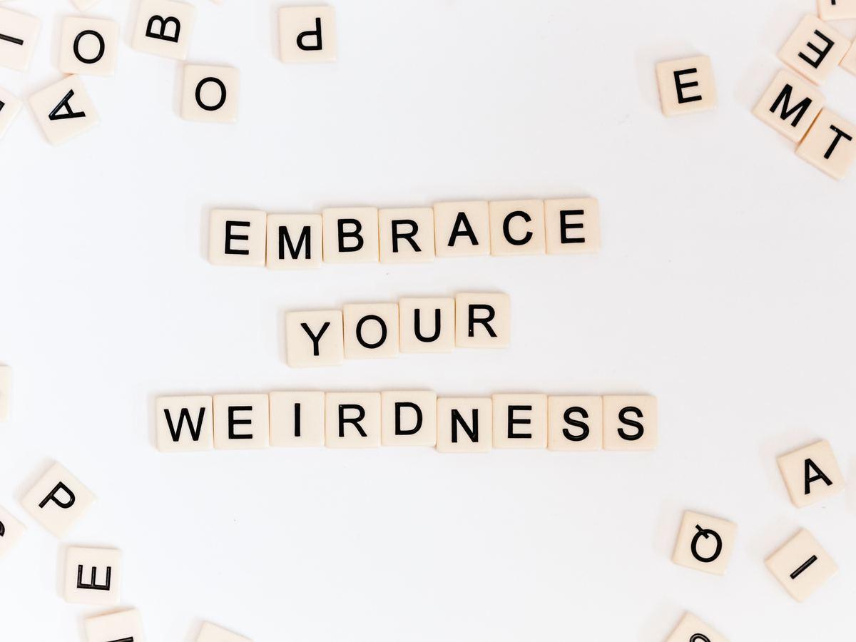 scrabble tiles read: embrace your weird
