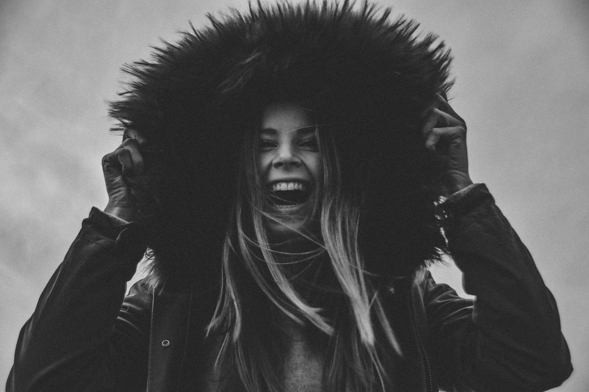 girl ecstatically laughing