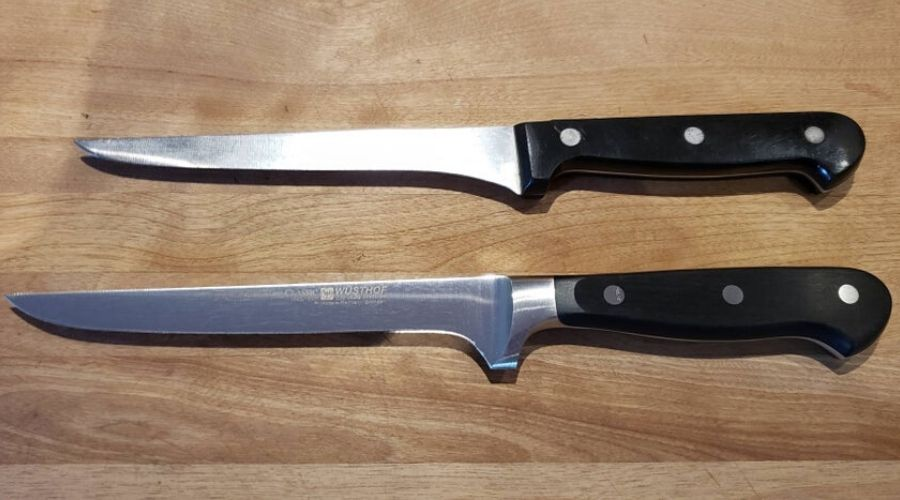 two of the same knives, one has been worn down