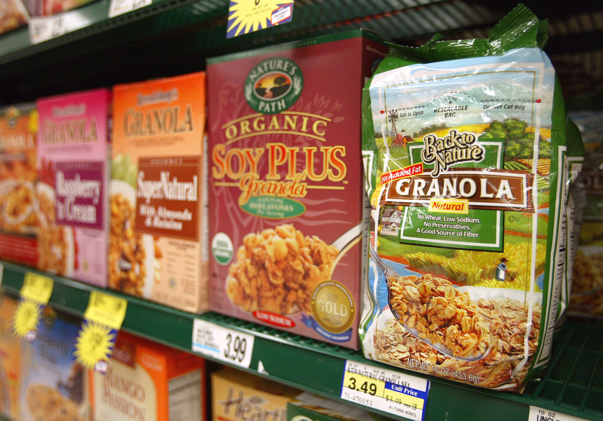Granola cereal bags are seen on a shelf inside a grocery store.