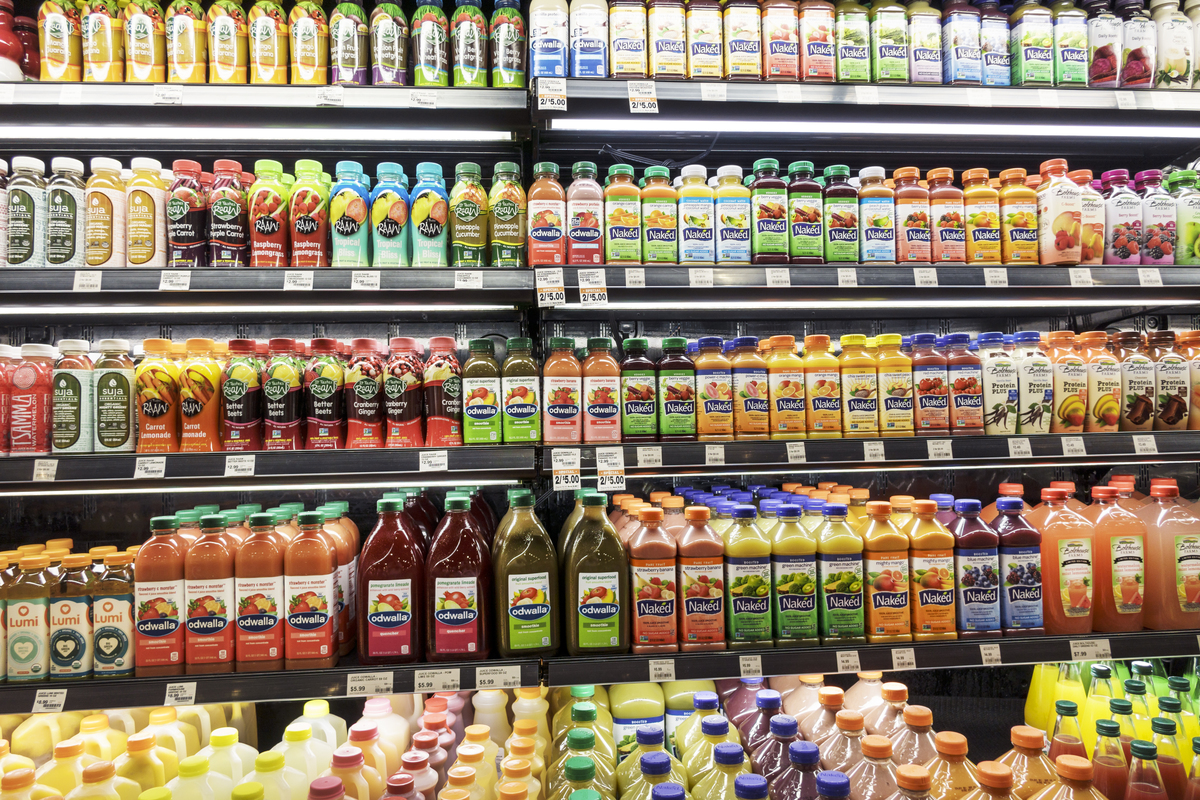 Bottled smoothies on shelves are for sale at the supermarket.