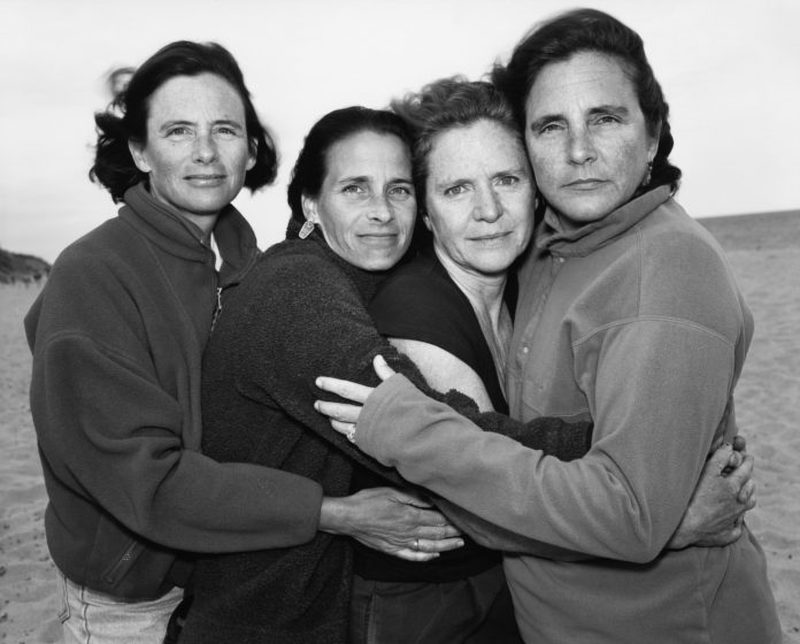 four sisters hugging