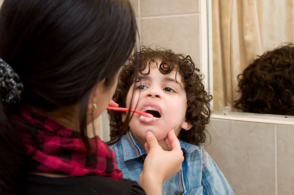 kid getting his teeth cleaned