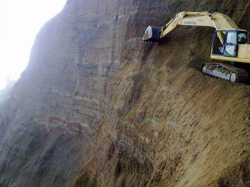escavator-on-cliff