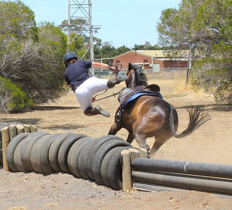 girl-falling-off-horse