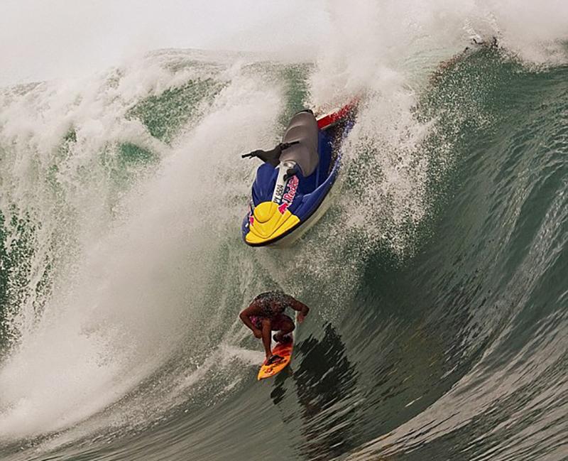 jetski-above-surfer-on-wave
