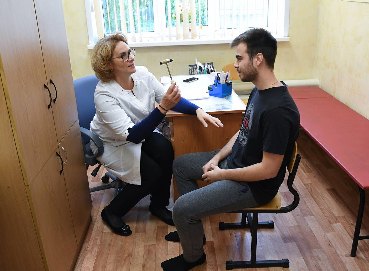 A man receives a medical examination in a doctor's office.