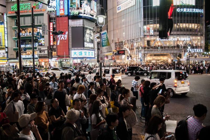 People crowd the Shibuya Crossing in Tokyo.