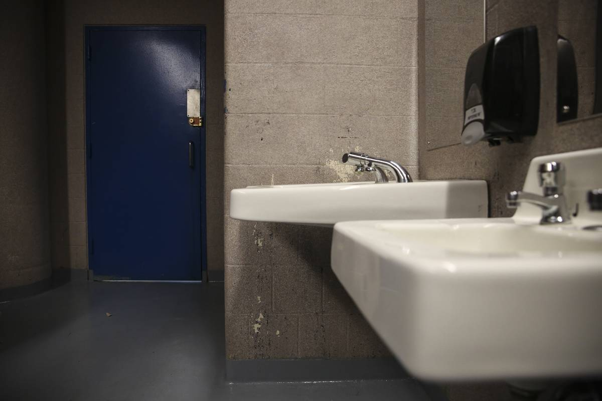 A public restroom is seen in a Boston High School.