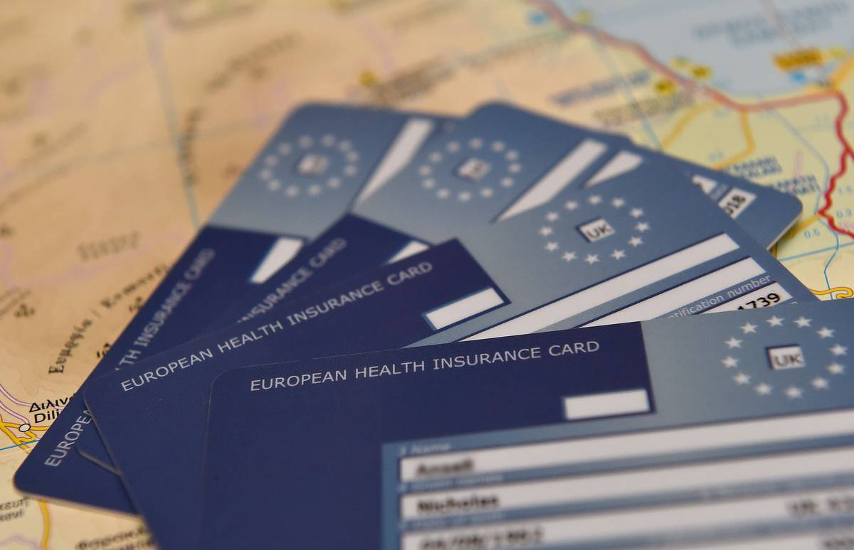 European Health Insurance Cards (EHIC) sit on a map.