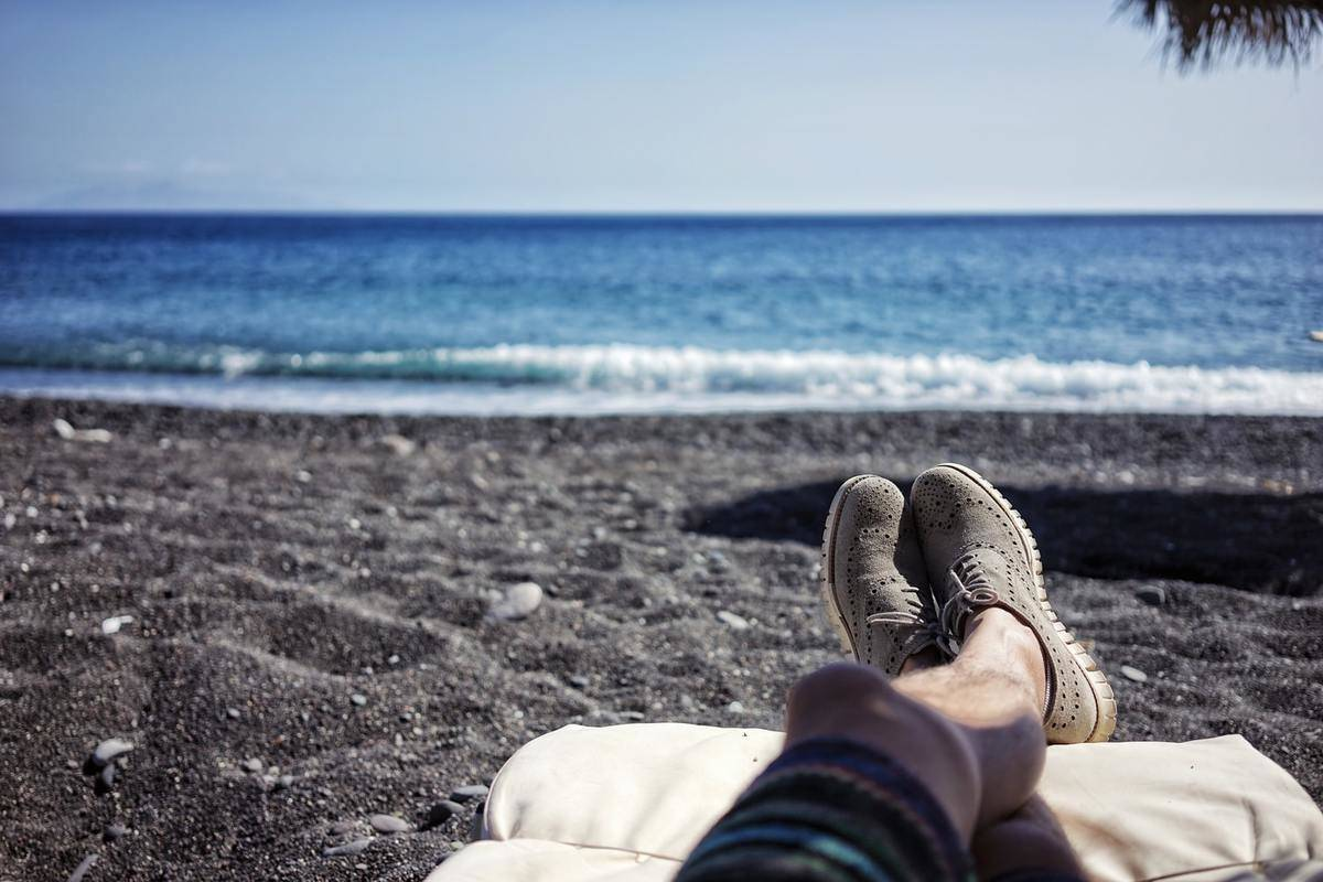 A person relaxes on the beach during a vacation.