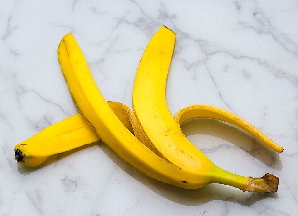Yellow banana peel over floor marble surface.