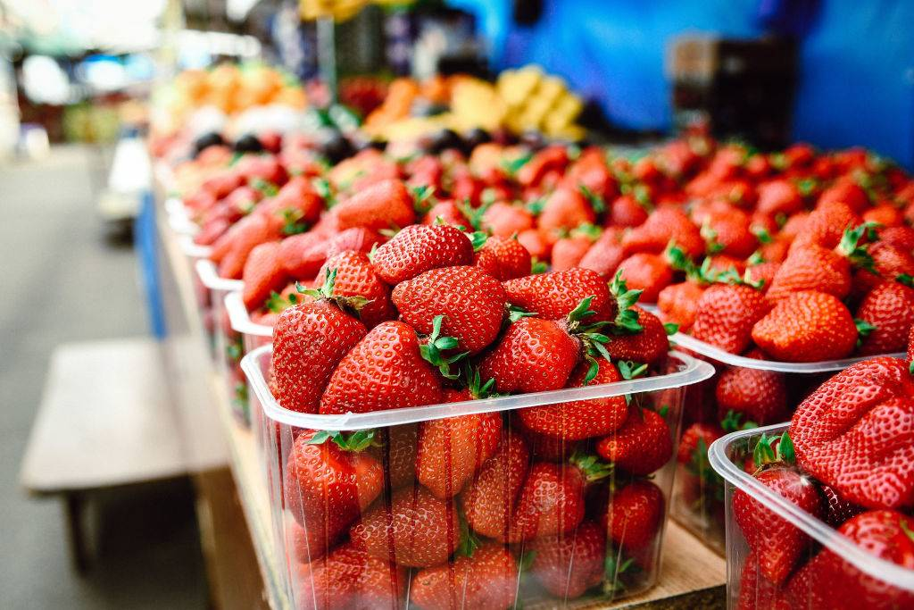Strawberries are sold at the Roofed Market