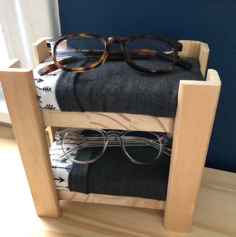 someone made a bunch bed for their kid's glasses