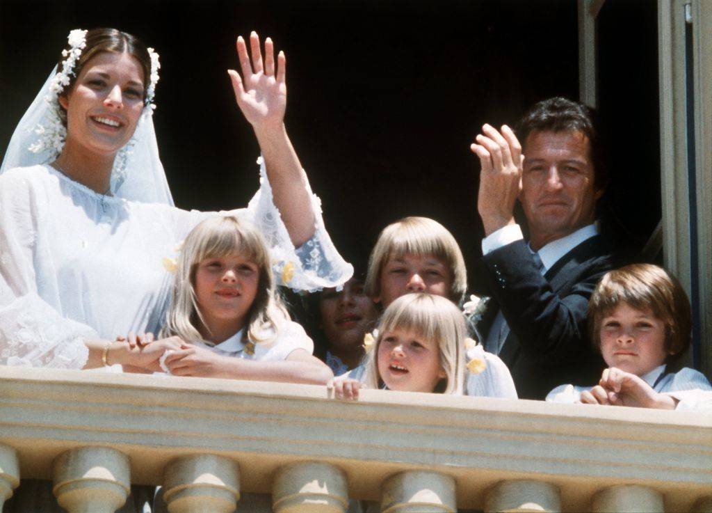 With a happy smile Princess Caroline of Monaco and her husband Philippe Junot wave to the public from the balcony