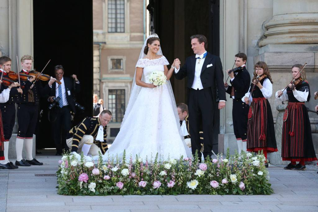 Princess Madeleine of Sweden and Christopher O'Neill smile at well wishers following their marriage ceremony