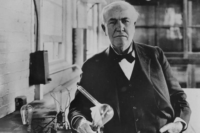 Thomas Edison with light bulb