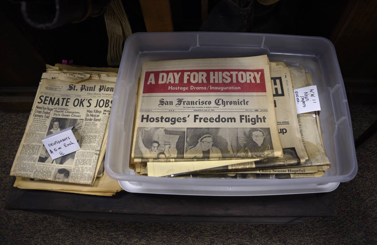 Historic newspapers for sale in an antique shop
