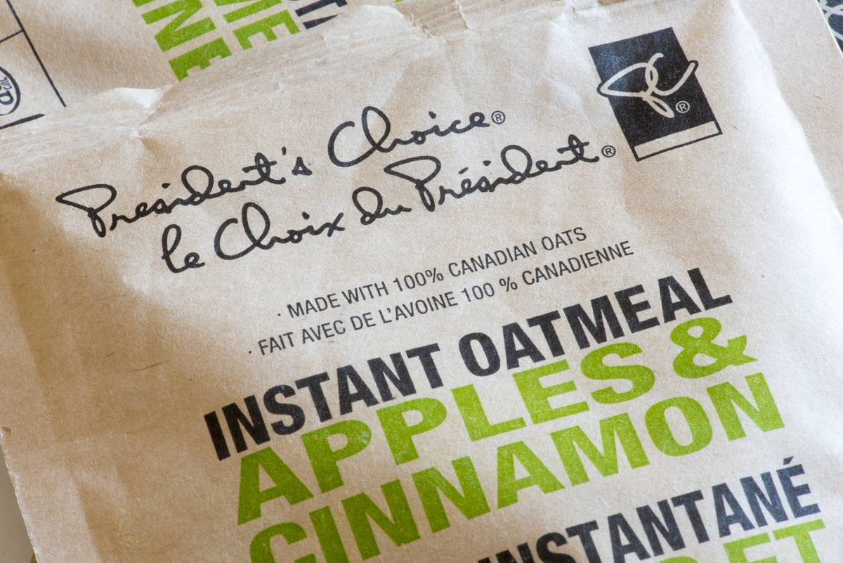 A close-up shows an instant packet of apple cinnamon oatmeal.