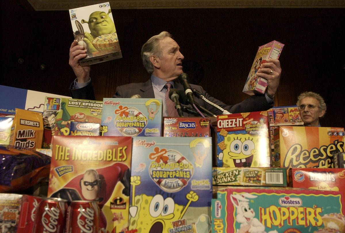 A man looks at sugary kid's cereals in disbelief.