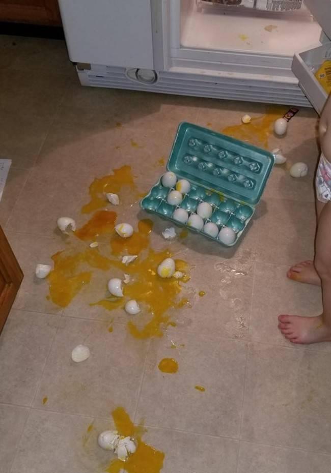 three year old broke carton of eggs on the floor
