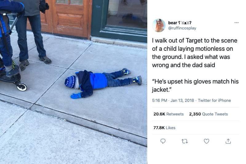 child lying on ground upset because gloves and coat match