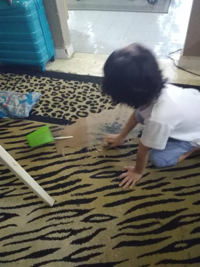 child spilled hot chocolate then proceeded to rub it into the cotton pattern rug