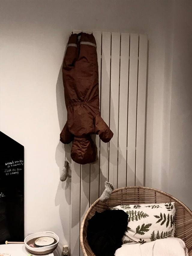 snowsuit hanging to dry scared parent