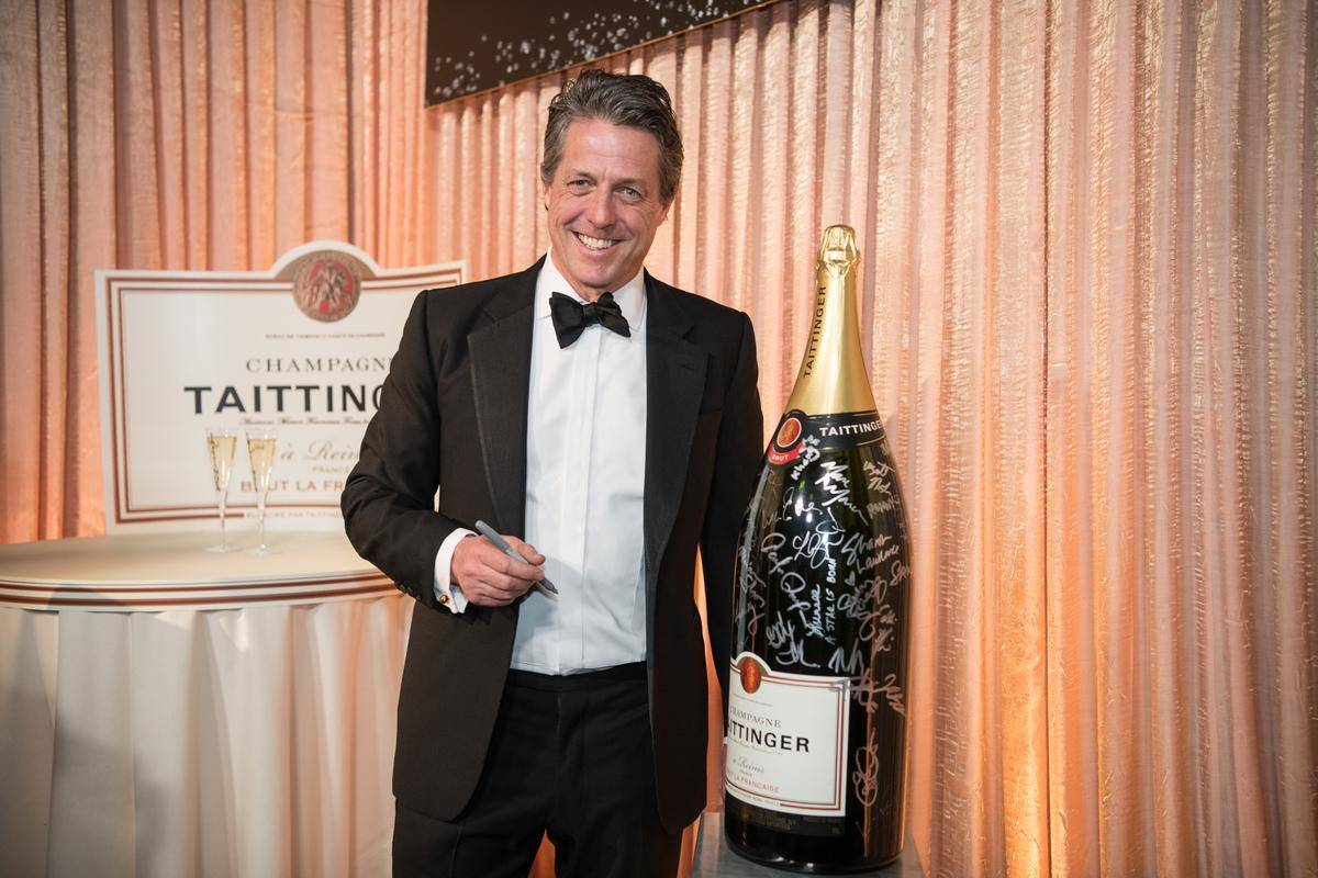 GettyImages-1125525614-80737 posing with giant champagne
